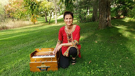 Kathleen Karlsen with a harmonium for leading mantras and chanting