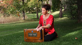 Kathleen Karlsen playing harmonium and chanting