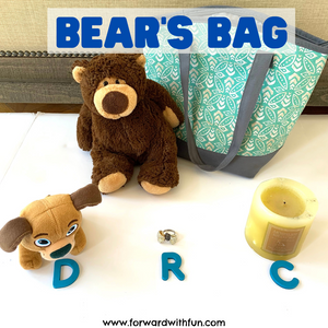 Bear with a bag, letter D with Dog, letter R with ring, letter C with candle