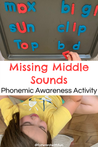 child placing magnetic letters on a tray