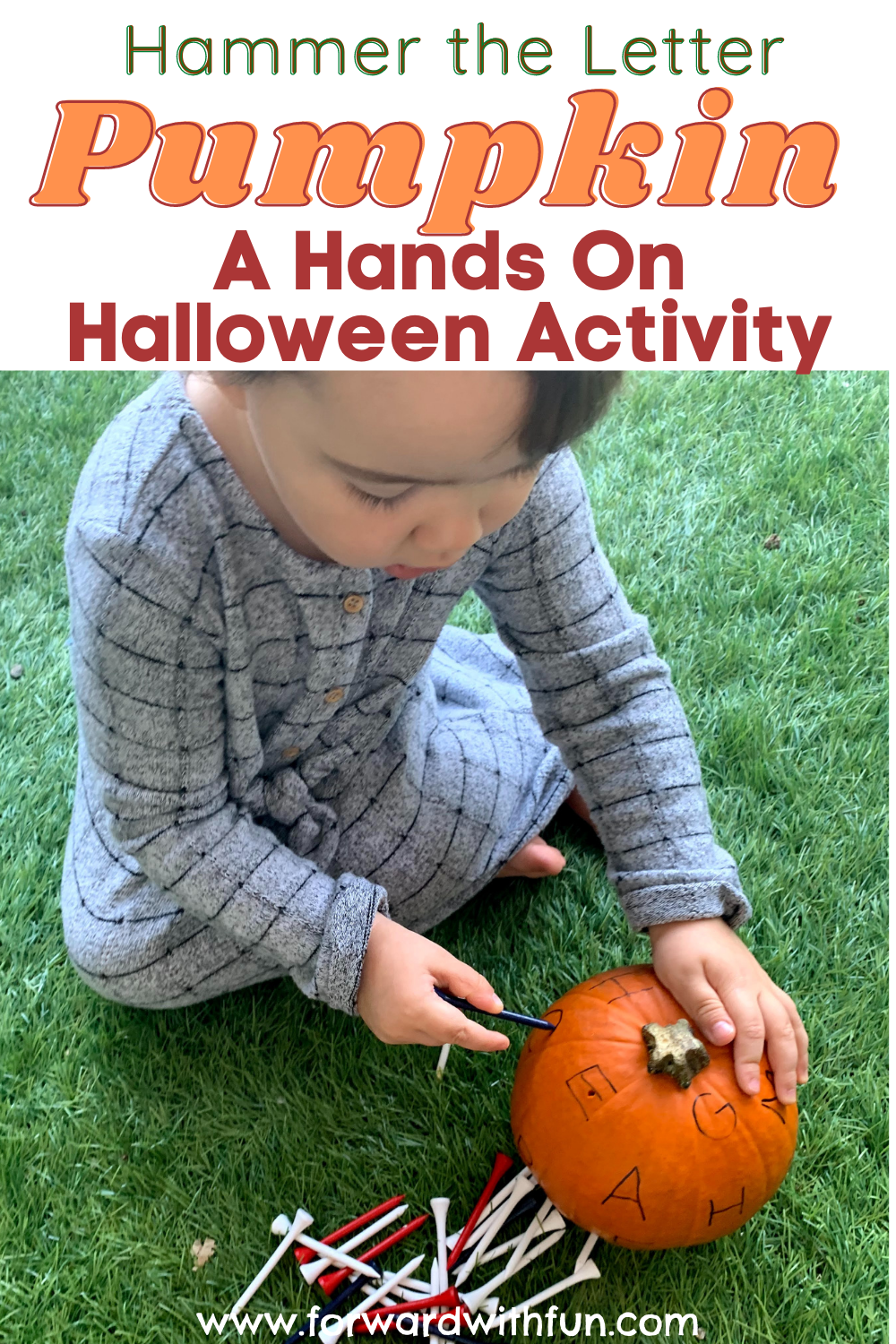 Small child hammering golf tees into a pumpkin
