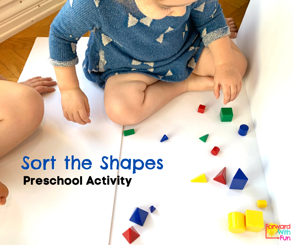 Child sorting 3d shapes by attribute