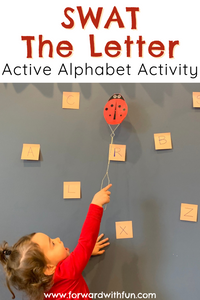 Child swatting letters on a wall