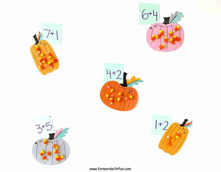 Candy corn is used to solve addition problems written on each pumpkin