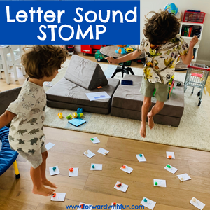 Two children jumping on letters