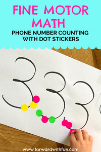 child affixing dot stickers to a phone number