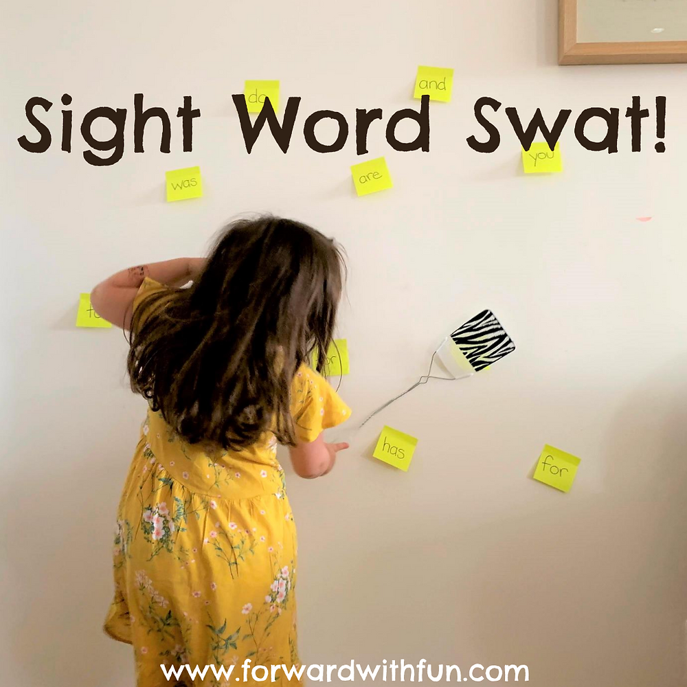 child swatting sight words on the wall with a fly swatter