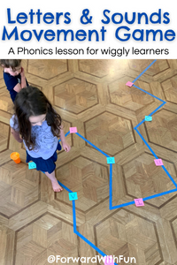 child walking across a zig zag path with letters on it