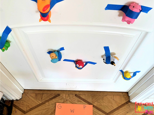 Toys taped to a white door