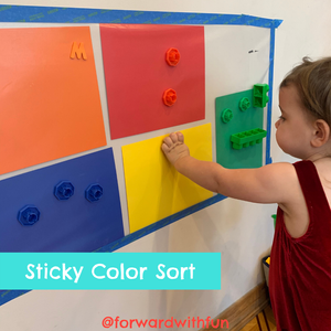 Place colored construction paper behind the sticky wall and have your child sort items by color