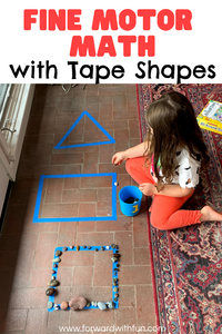 Child placing rocks on a triangle, rectangle, and square made of blue tape