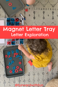Baby placing letters on the tray and associating them with their sounds.