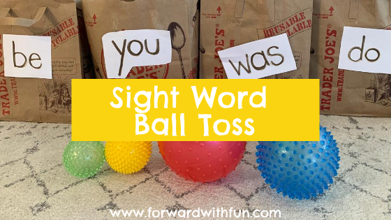 throwing balls into bags that have sight words on them