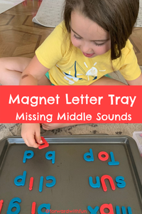 Child finding the missing vowel letters using knowledge of sounds to make words with magnet letters on a tray.