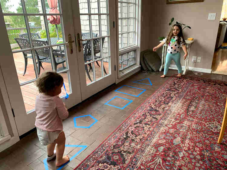 Hopscotch and taking turns running through the shapes