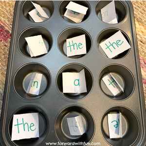 index cards with sight words written on them in each muffin pan