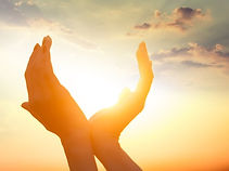 bigstock-Hands-Holding-The-Sun-At-Dawn-8
