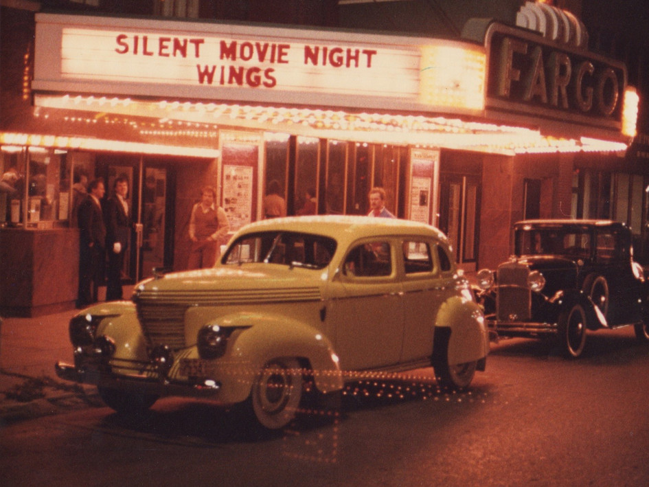 "Taken at a Silent Movie Night between 1974 and 1999. The movie shown was called ""Wings,"" a drama/romance film from 1927 that takes place during World War I.   A point of interest in this photo is the original box office window and entrances on the left side of the photo. These were removed during the theatre's renovation/restoration in 1999/2000."
