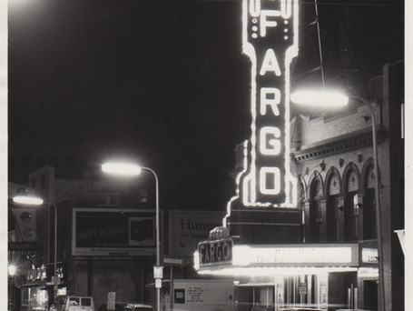 "Here is another pre-renovation photograph taken before 1999. Notice how the vertical marquee meets the horizontal marquee. The connecting section was added when the marquee was ""new"" in the 1930s art deco renovation, and then later removed when the marquee was updated in 1999."