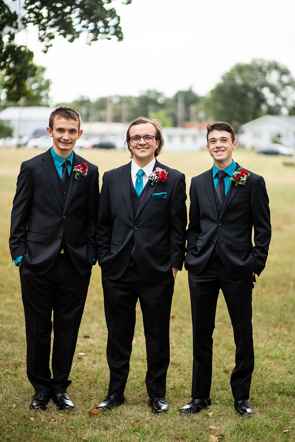 Groom and groomsmen standing next to each other