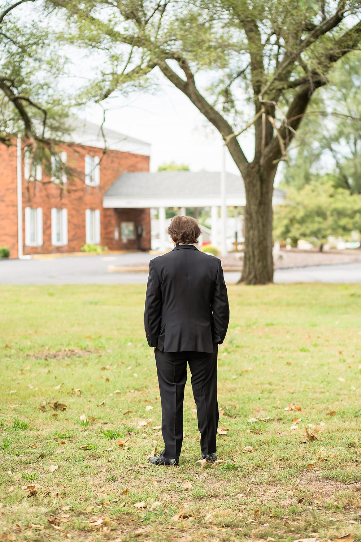 Groom waiting to see bride