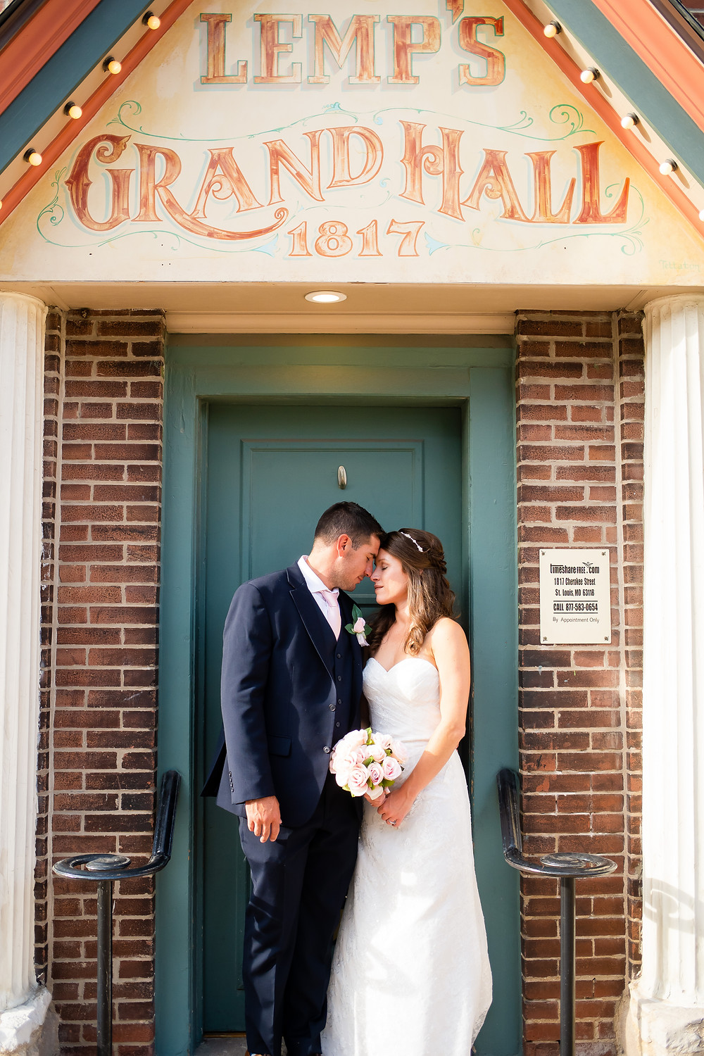 Bride and Groom portrait in front lamp's grand hall sign
