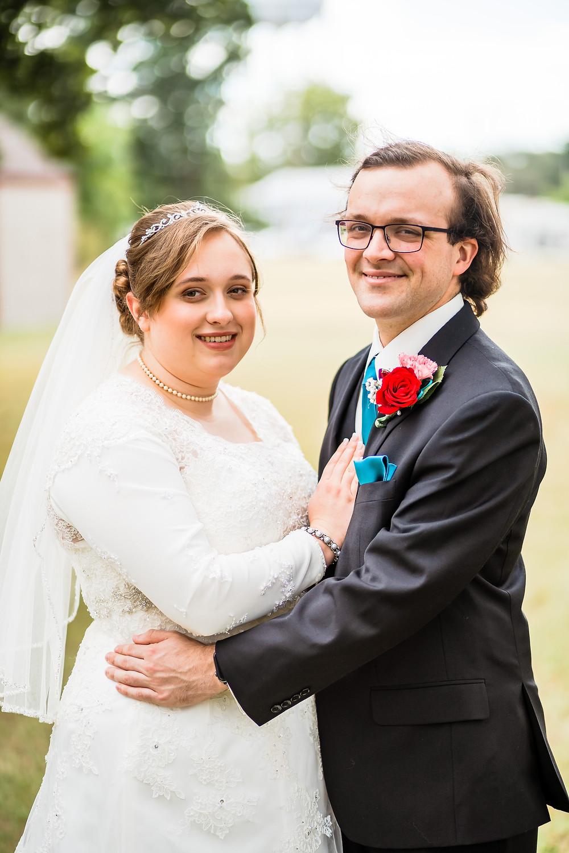 Bride and groom smiling at camera