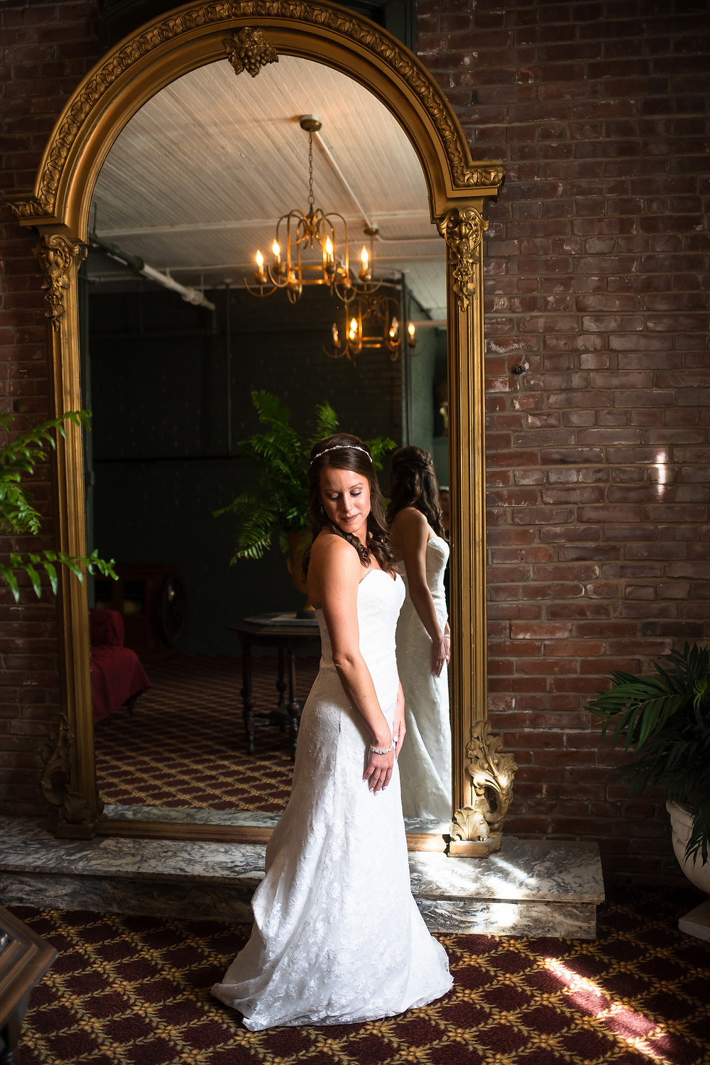 Bridal portrait in front of mirror