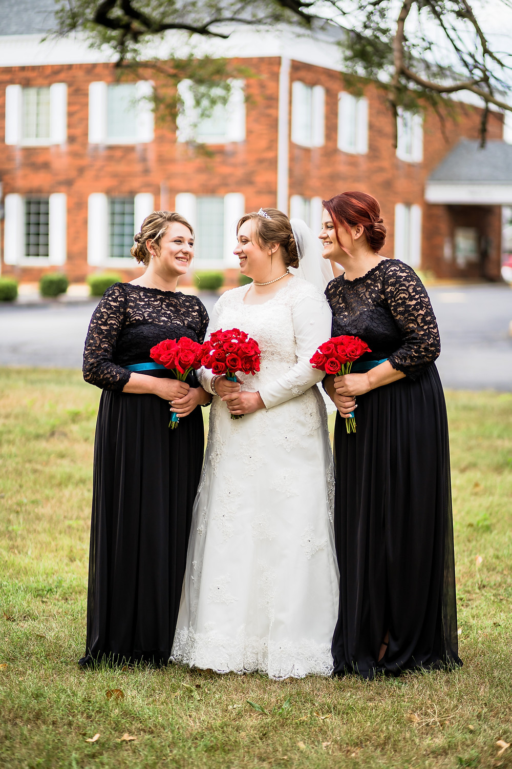 Bridesmaids smiling at each other