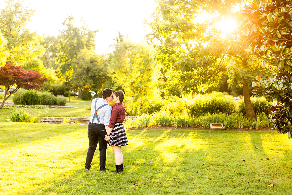 Couple kissing with the sun in the background