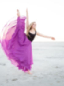 Portrait of a girl Dancing on the beach