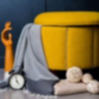 Product Photo of a scarf by a clock, wood, and a chair