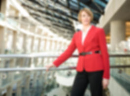 Product Photo of a women standing in her office