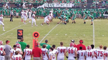 """Womack helps Hurricane """"limp"""" to a 24-13 victory."""
