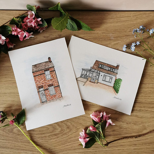 Jessica Sian Illustration, Two A5 House Paintings on a wooden table surrounded by pink flowers