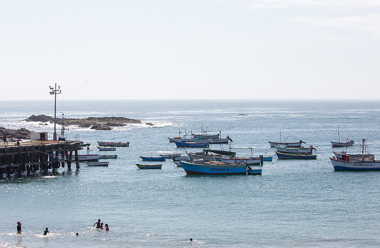 Fish boats at the harbour of Chala, Per