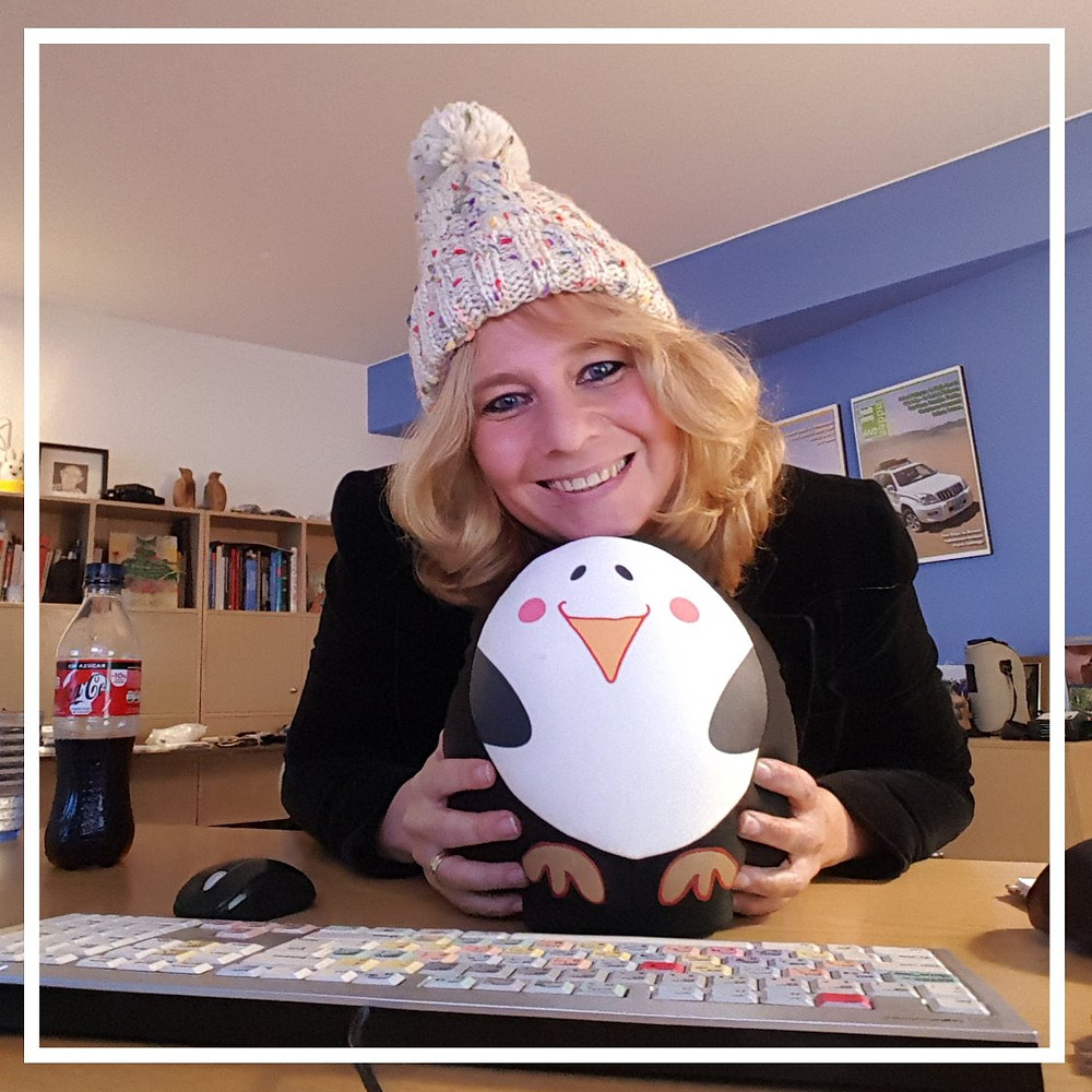 Hat with pengiun cuddle