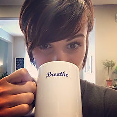 woman drinking from bravehoods cup