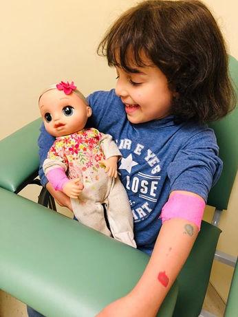 young girl wearing bravehoods shirt