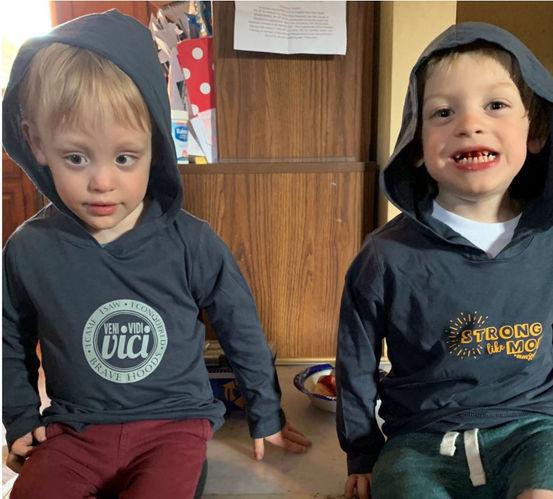 brothers sitting wearing bravehoods