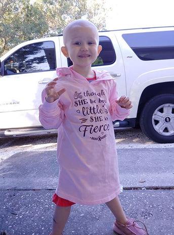 pedatric cancer patient wearing bravehoods shirt
