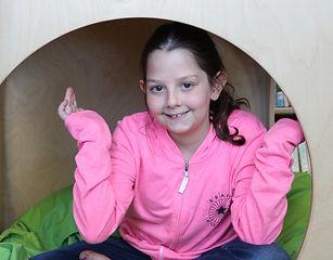 young girl wearing bravehoods hoodie