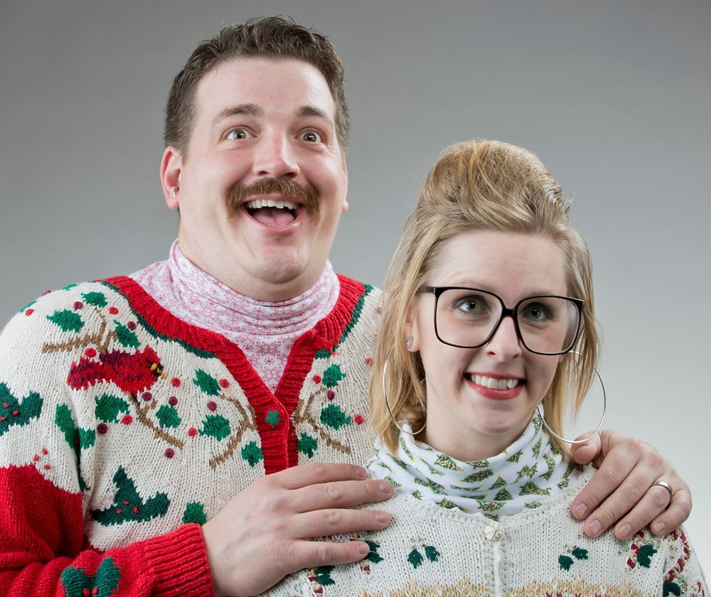 A couple looking awkward in a holiday photo