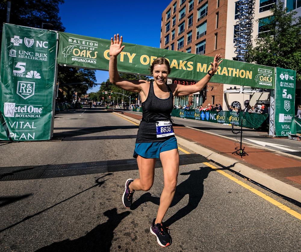 Business owner crossing marathon finish line