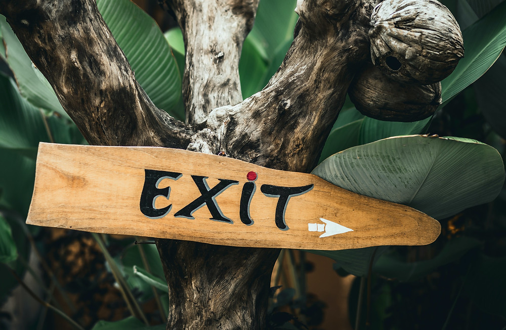 cute wooden sign that says exit
