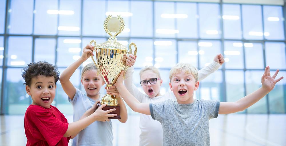 Kids celebrating winning an award