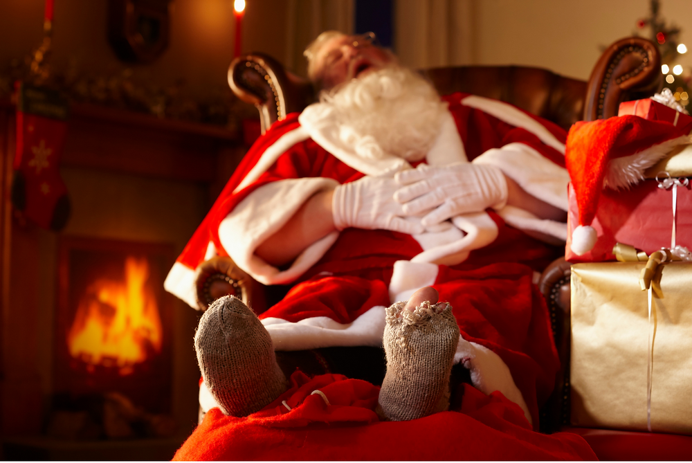 Santa asleep in a chair
