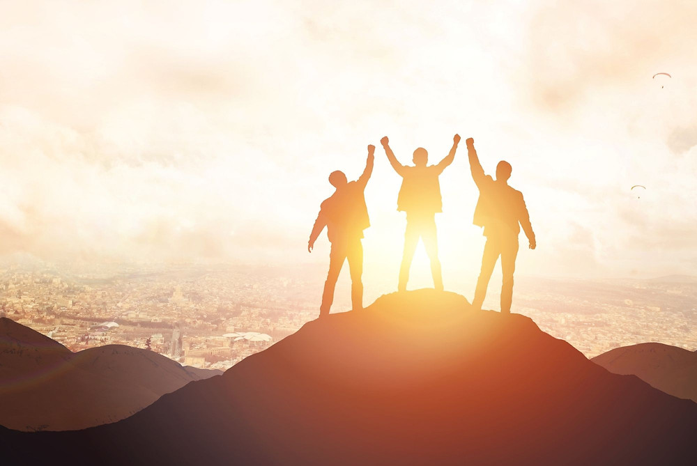 business leaders celebrating reaching the summit