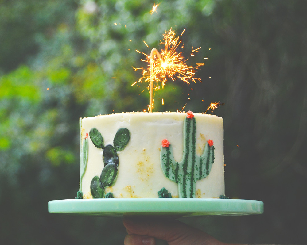 Birthday cake with cacti on it.