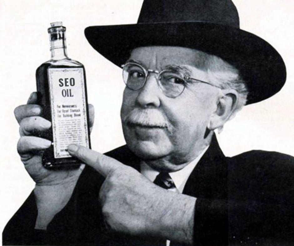 Snake oil salesman holding a bottle of SEO oil